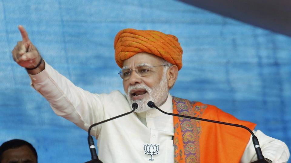 PM Narendra Modi addresses an election rally at Dhandhuka village of Ahmedabad district on Wednesday.