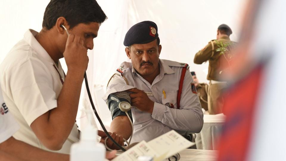 A traffic policeman gets his blood pressure checked during the camp. A cross-section of policemen, HT spoke to at the camp said fear for their safety caused the majority of their stress. They added that the demanding schedule and Delhi's pollution in the recent weeks has also played a major role in aggravating the situation. (Raj K Raj / HT Photo)
