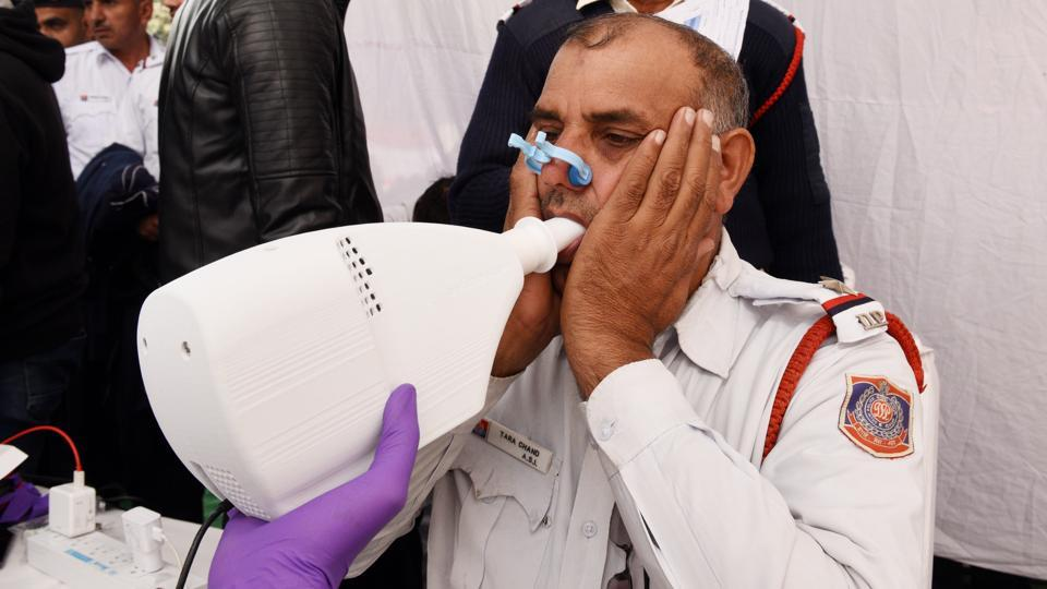 Amid Delhi's air pollution crisis, the city's traffic police organised a three day health check-up camp for its officers beginning Monday. Among preliminary findings, one in seven traffic policemen in Delhi was diagnosed with respiratory disorders, in the camp aiming to evaluate the effects of air pollution on the health of the force. (Raj K Raj / HT Photo)