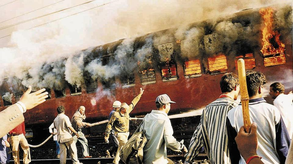 In 2002, under pressure from VHP, the Centre filed an application in the Supreme Court for vacating the 'interim order' banning any religious activity in Ayodhya. On February 6, 2002 at least 59 people were killed when a train in Godhra, Gujarat carrying kar sevaks from Ayodhya was attacked. As a result, riots erupted across Gujarat in which over 1,000 people were killed. (AP)