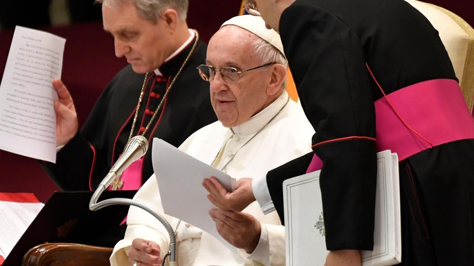 Pope Francis (C) gives a weekly general audience at the Paul VI audience hall in Vatican.