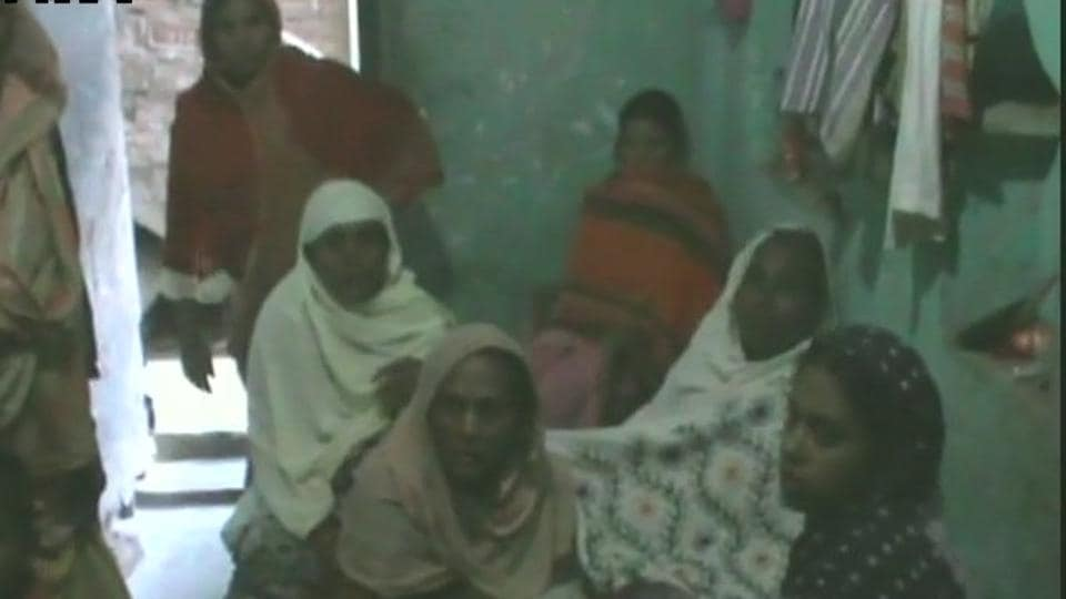 Family members of Afrazul at their home in West Bengal's Malda district.