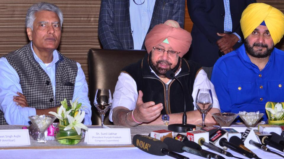 Punjab chief minister Captain Amarinder Singh (centre) with Punjab Congress chief Sunil Jakhar (left) and Punjab local bodies minister Navjot Singh Sidhu (right) addressing a press conference in Amritsar on Thursday.