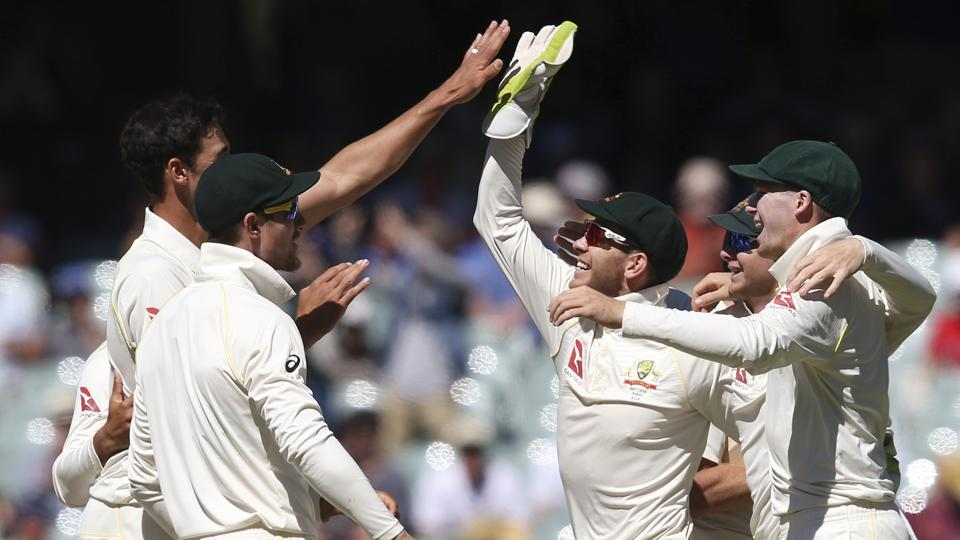 Australian players celebrate at the end of the second Ashes Test in Adelaide.