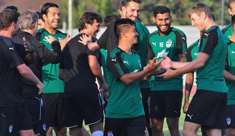 Bengaluru FC captain Sunil Chhetri shares a light moment with teammates during a practice session for their Indian Super League (ISL) match against NorthEast United FC at the Indira Gandhi National Athletic Stadium in Guwahati on Thursday.