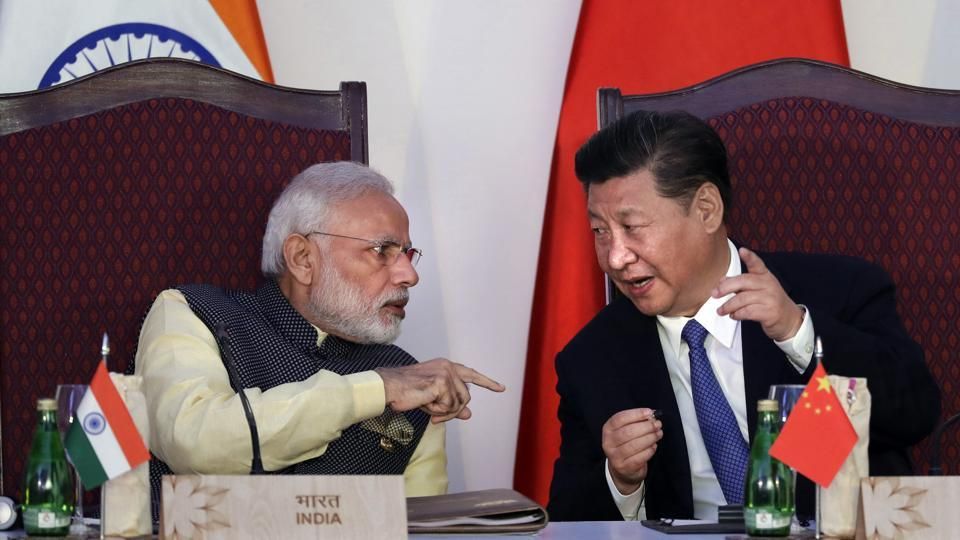Prime Minister Narendra Modi with Chinese President Xi Jinping at the BRICS summit in Goa.