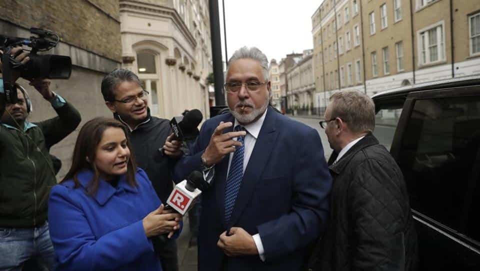 Vijay Mallya smokes as he arrives for the third day of his extradition case at Westminster Magistrates Court in London.