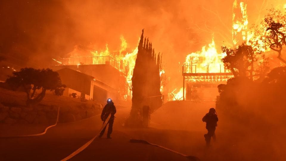 The flames have swallowed about 80,000 acres (32,000 hectares) in just over a day since the Thomas fire, currently the state's largest, broke out, leaving at least one dead in an area about 45 minutes from downtown LA. The inferno engulfed the Los Angeles region on Wednesday, forced more than 200,000 people to flee and threatening thousands of homes. (Ryan Cullom / Ventura County Fire Department via AP)