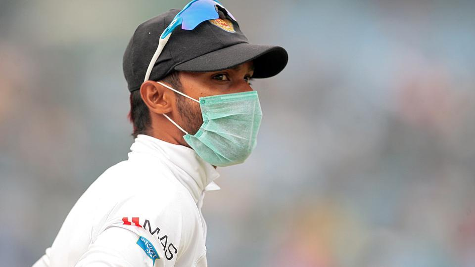 A Sri Lankan player, wearing a face mask, stands at the Feroz Shah Kotla during the third India vs Sri Lanka Test that ended in a draw on December 6, 2017. Delhi's air pollution marred the match that ended in a draw.