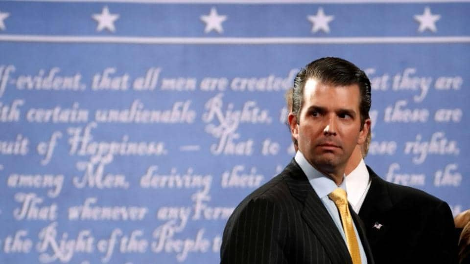 Donald Trump Jr. stands onstage with his father Republican U.S. presidential nominee Donald Trump after Trump's debate against Democratic nominee Hillary Clinton at Hofstra University in Hempstead, New York, U.S. on September 26, 2016. SM