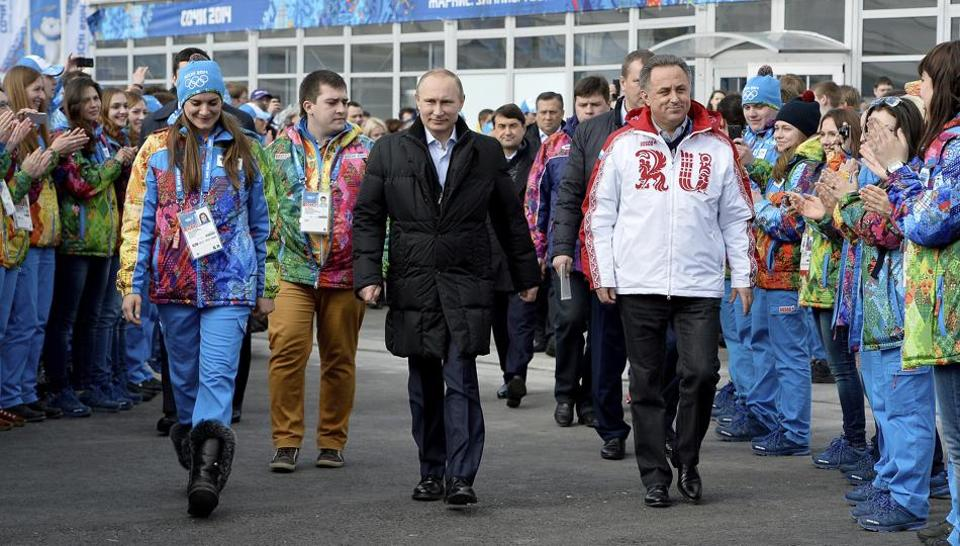 In this Feb. 5, 2014 file photo Russian President Vladimir Putin, center, visits the Olympic Athletes Village in Coastal Cluster ahead of the Sochi 2014 Winter Olympics with Olympic Village Mayor Elena Isinbaeva, left, and Russian Minister of Sport, Tourism and Youth policy Vitaly Mutko in Sochi.