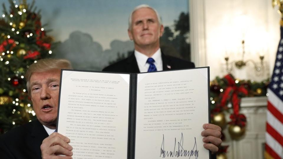 Vice President Mike Pence looks on as US President Donald Trump displays an executive order ratifying US recognition of Jerusalem as the capital of Israel, on December 6, 2017. In doing so, Trump departed from longtime US policy and potentially threatens regional stability, despite warnings from Western and Arab allies. (Kevin Lamarque / REUTERS)