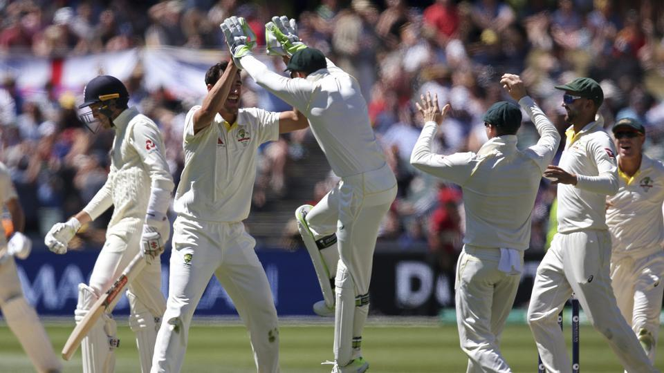 Mitchell Starc celebrates with teammates after taking the wicket of England's Craig Overton. Starc believes the Australian cricket team can become even better.