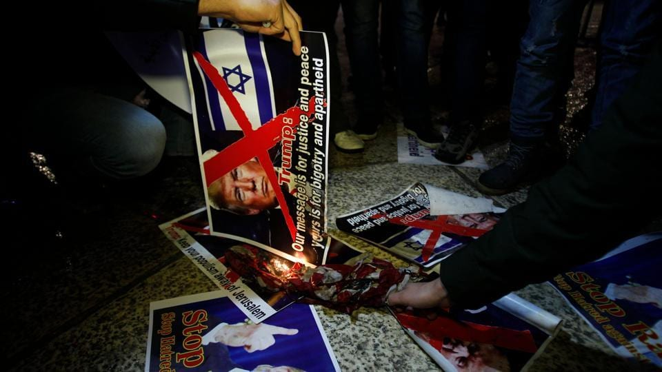 Palestinian demonstrators burn posters of the US president in Bethlehem in protest of the declaration on December 6, 2017. Palestinian president, Mahmoud Abbas, a veteran of the peace process, said bitterly that the United States had effectively scrapped it. Saeb Erekat, the chief Palestinian negotiator, called for the abandonment of a two-state solution altogether. (Musa Al Shaer / AFP)