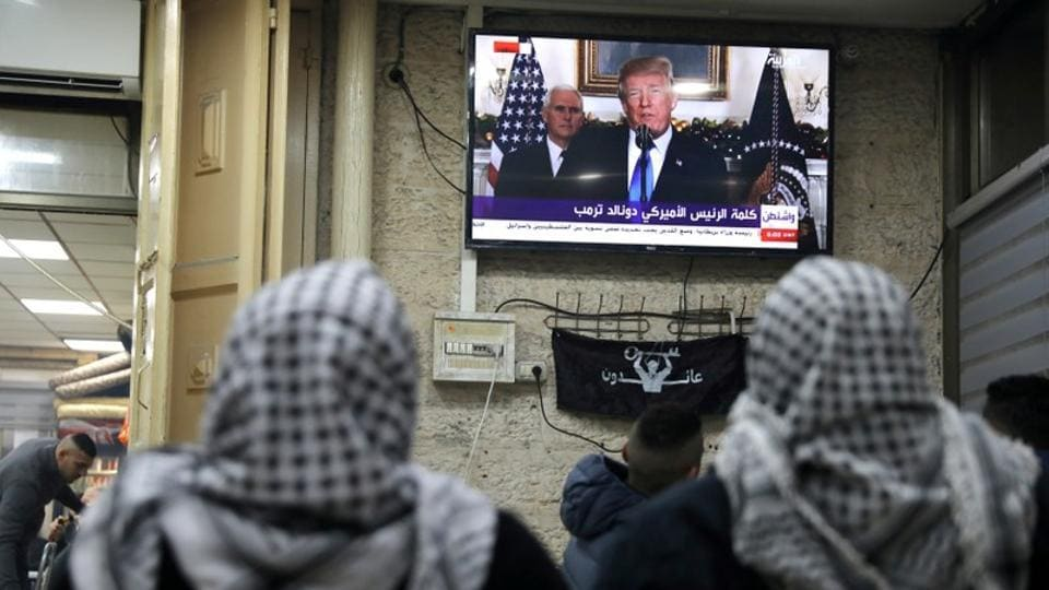 "Palestinians watch a broadcast of US President Trump delivering an address where he announced that the US recognises Jerusalem as the capital of Israel. Trump said, this is ""a long overdue step to advance the peace process."" Adding that the US still wanted a negotiated peace agreement — and ""would support a two-state solution if agreed to by both sides"". (Ammar Awad / REUTERS)"