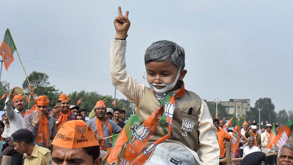 A child dressed as Prime Minister Narendra Modi at the PM's 'Gujarat Vikas Rally' in Surat.