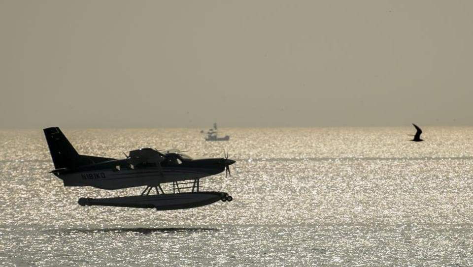 The seaplane flies at Marine Drive on Thursday.
