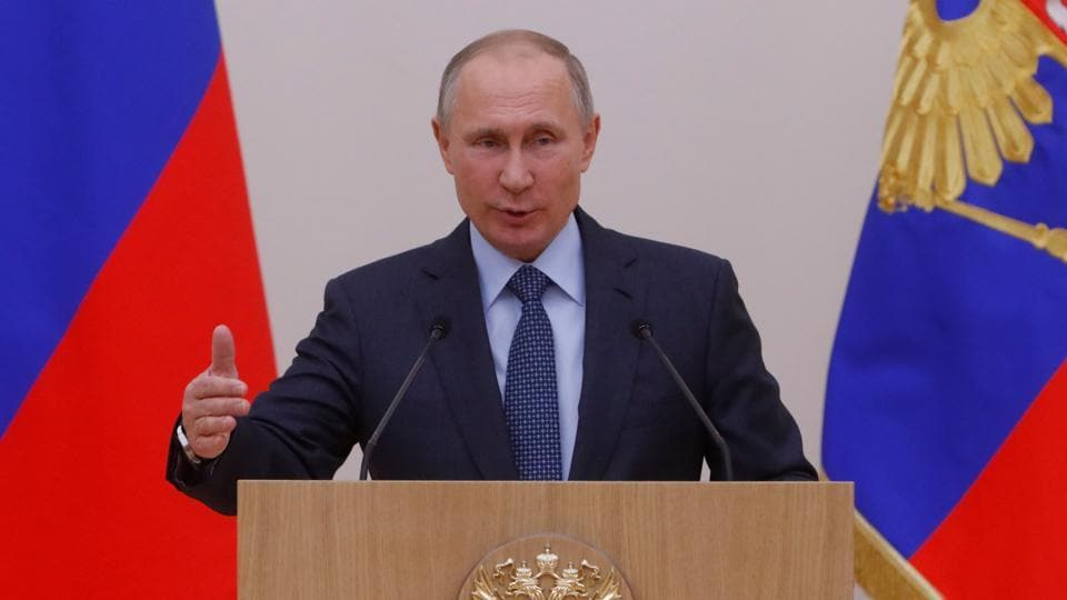 Russian President Vladimir Putin addresses officials of Rostec high-technology state corporation at the Novo-Ogaryovo state residence outside Moscow, Russia.