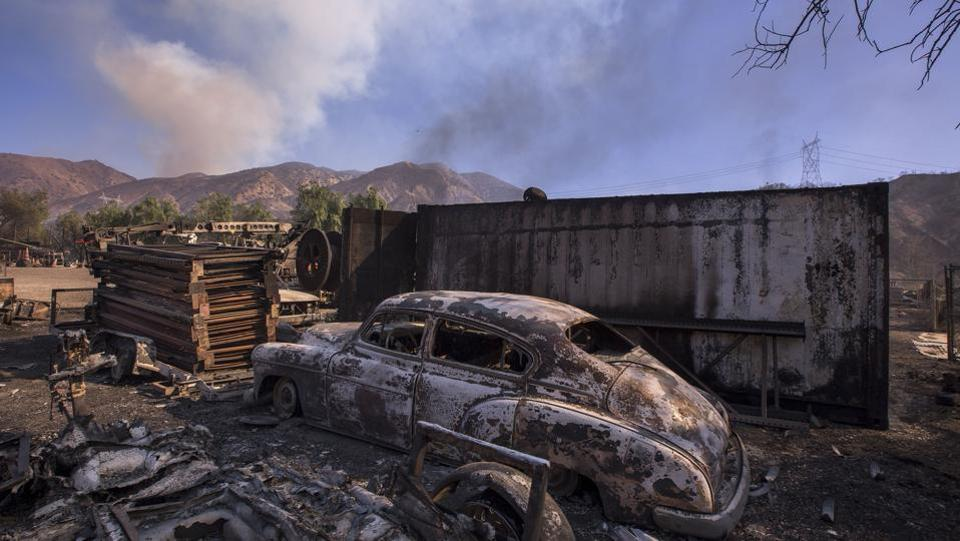 A burned classic car is seen in Little Tujunga Canyon during the Creek Fire on December 6, 2017 near Sylmar, California. In the San Fernando Valley north of Los Angeles, the Creek Fire destroyed at least 30 homes, blackened more than 11,000 acres and forced the evacuation of 2,500 homes. (Reed Saxon / Getty Images / AFP)