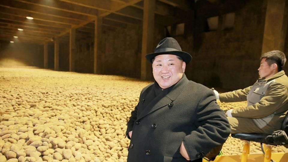 This undated picture released from North Korea's official Korean Central News Agency (KCNA) on December 6, 2017 shows North Korean leader Kim Jong-Un (L) inspecting the newly-built Samjiyon potato farina production factory in Ryanggang Province, North Korea.