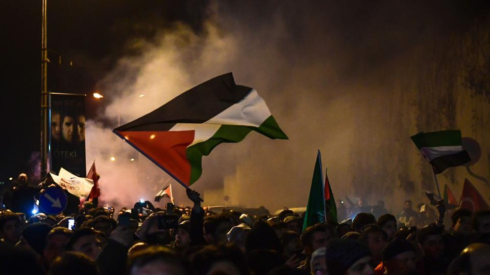 Protesters wave Palestinian flags during a demonstration against the US and Israel in front of the US consulate in Istanbul on December 6, 2017.