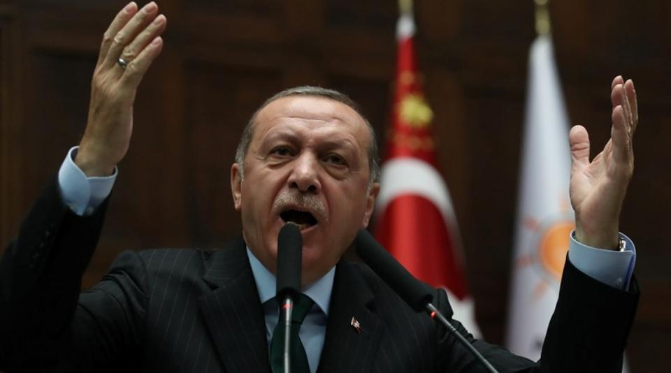 Turkey's President Tayyip Erdogan addresses members of parliament from his ruling AK Party (AKP) during a meeting at the Turkish parliament in Ankara, Turkey, December 5, 2017.
