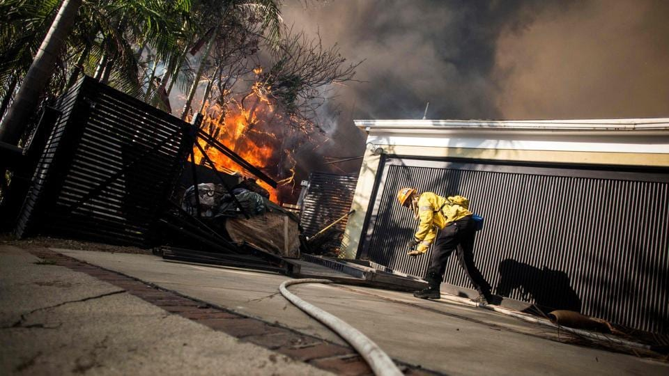 Firefighters work to save burning houses along Linda Flora Drive during the Skirball fire in Los Angeles. As fires raged across Southern California, a new blaze erupted in the Bel-Air neighbourhood of Los Angeles, near iconic landmarks like the UCLA campus and the Getty Museum, home to old masters' paintings and ancient Roman statues. More than 1,770 firefighters and police officers are fighting these wildfires. (Kyle Grillot / AFP)