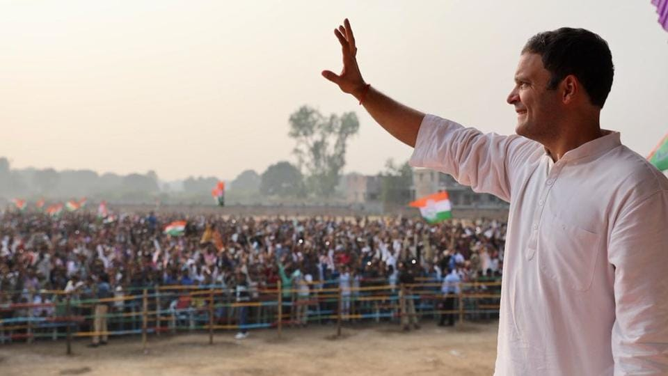 Congress vice president Rahul Gandhi greets the crowd at a rally in Gujarat's Anand on Friday.