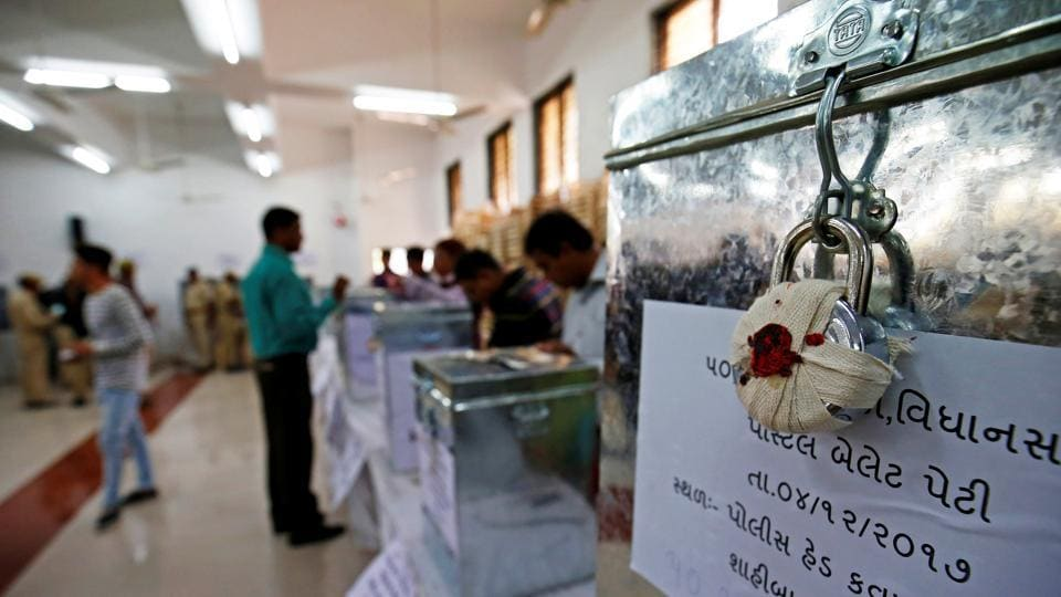 Sealed ballet boxes are seen inside the polling centre during postal ballot voting ahead of Gujarat state assembly elections, in Ahmedabad.