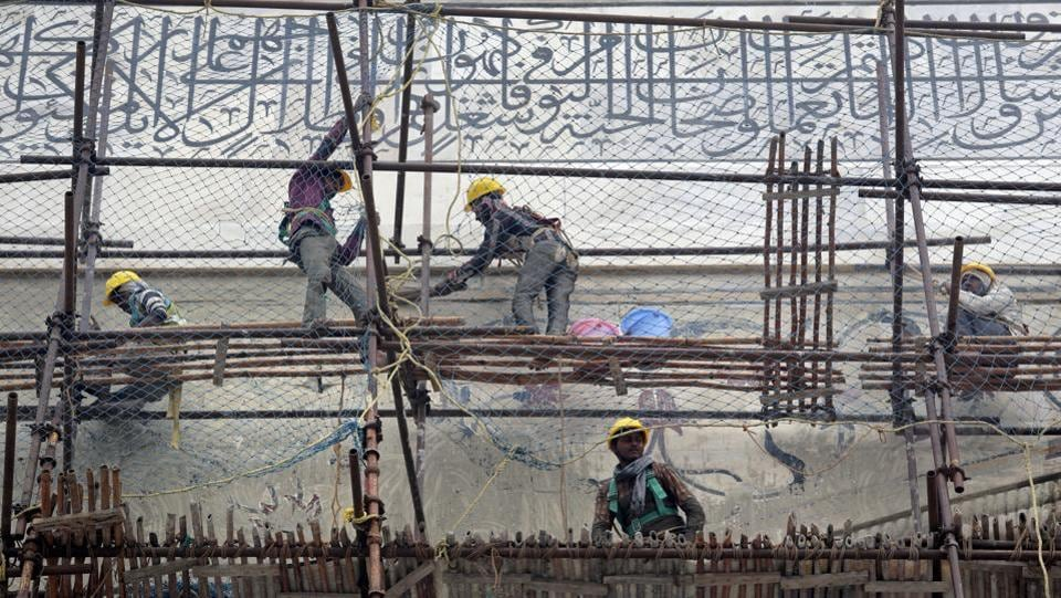 Workers peel off fuller's earth from the walls of the Taj Mahal. The dome's restoration will likely take 10 months, starting next year and finishing in 2019 with the makeover costing about $500,000. The work has prompted Fodor's Travel guide to include the Taj on its list of places to avoid next year. Vikrama counters, saying photographs from the 1940s with scaffolding on the dome are interesting and historically important.