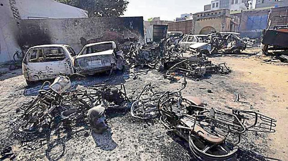 Vehicles torched at a Jhajjar police station during the Jat stir.