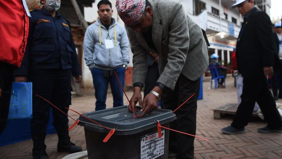 A Nepali election worker seals a ballot box after polling stations closed in Kathmandu on December 7, 2017.