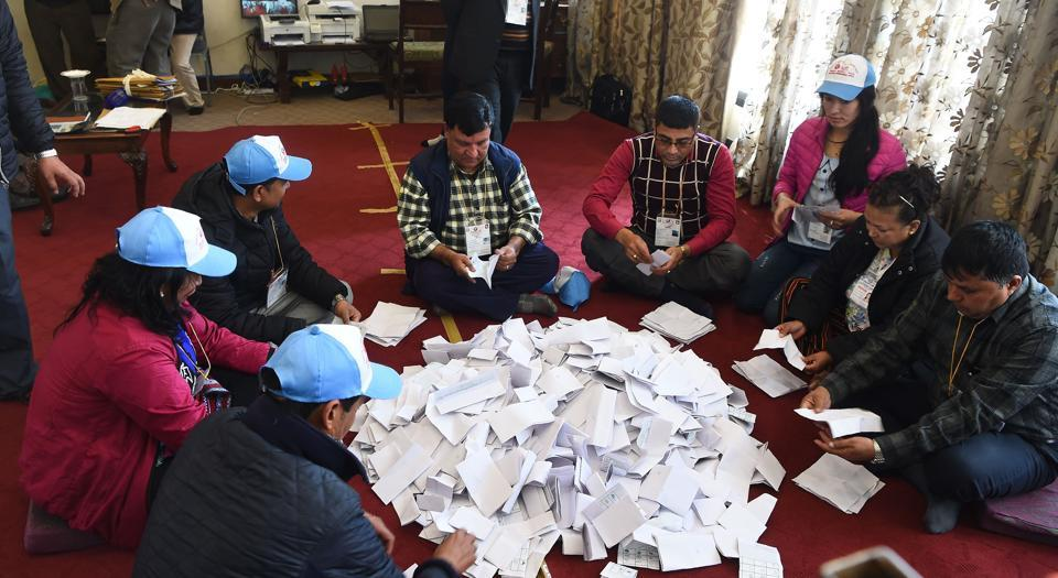 Nepalese Election Commission officials rearrange ballot papers in Kathmandu on December 8, 2017. Nepal has concluded historic parliamentary elections aimed at drawing a line under years of conflict and political turmoil in the Himalayan country.