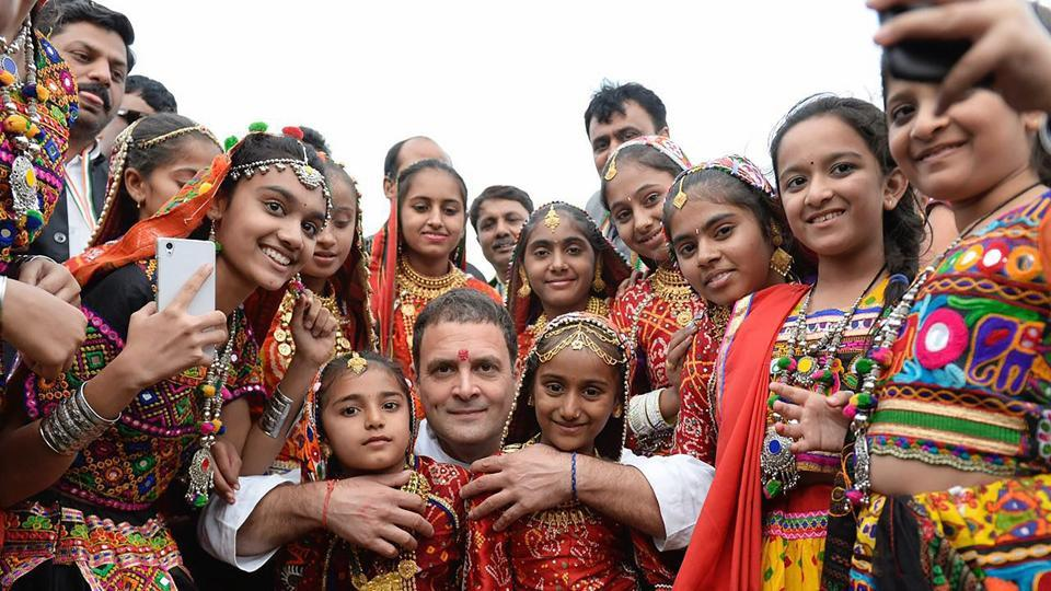 Congress Vice President Rahul Gandhi (C) poses for a photo with girls from the local area at an election campaign meeting at Anjar in Kutch district on Tuesday. (PTI)