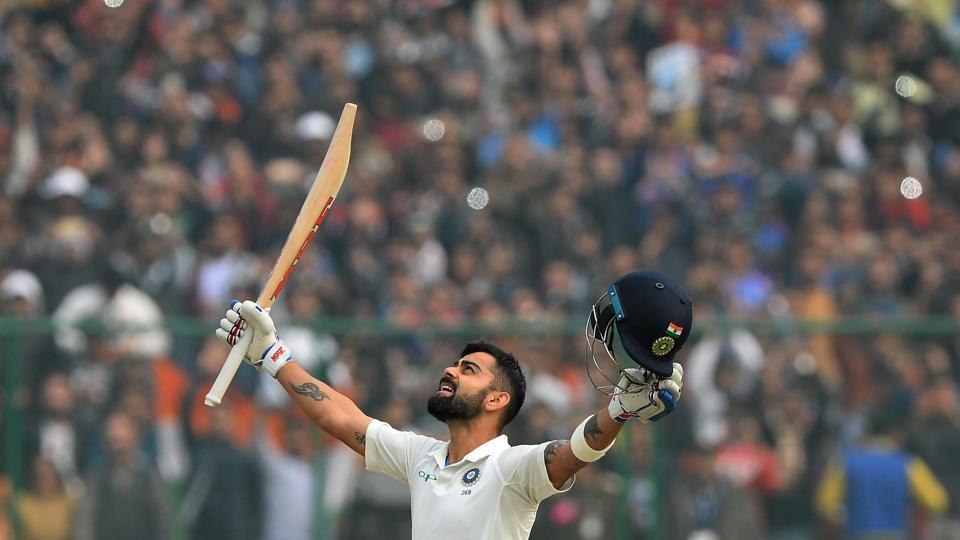 Virat Kohli raises his bat after completing his double century (200 runs) during the 2nd day of the 3rd Test match between India and Sri Lanka at the Feroz Shah Kotla Cricket Stadium in New Delhi on December 3, 2017. (Sajjad Hussain / AFP)