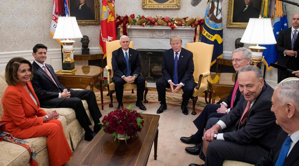 US President Donald Trump, alongside vice president Mike Pence (third from left), meets the Congressional leadership, including Senate majority leader Mitch McConnell, Senate minority leader Chuck Schumer, Speaker of the House Paul Ryan, and House Democratic leader Nancy Pelosi in the Oval Office at the White House in Washington on December 7, 2017.