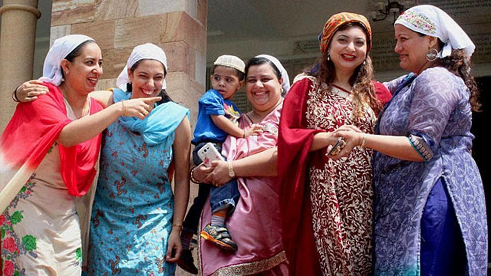 Women of Parsi community greet each other on the occasion of their New Year 'Navroz' in Nagpur, Maharashtra.