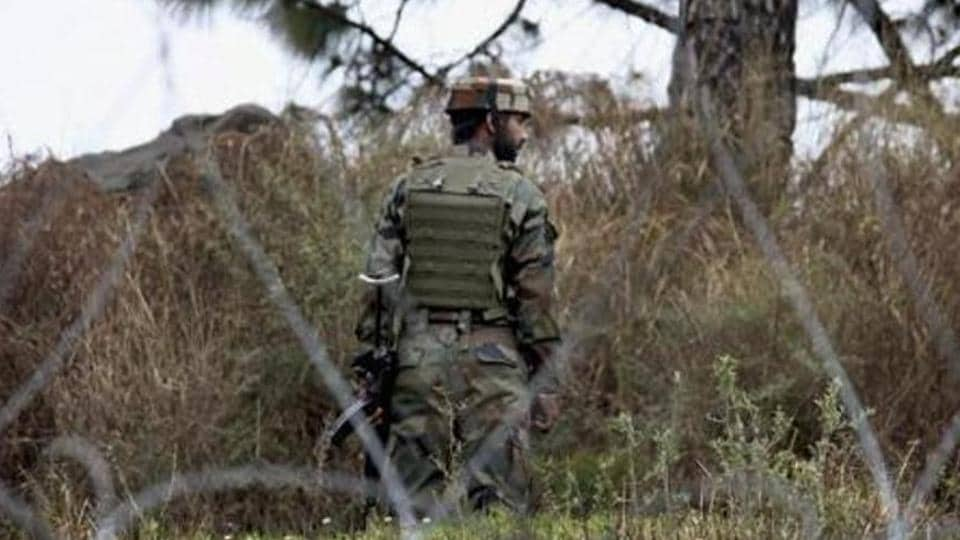 An Indian Army jawan patrolling at the Line of Control in Poonch district of Jammu and Kashmir.