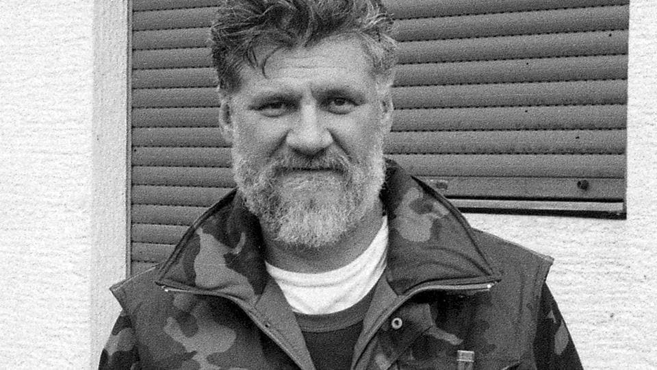 In this Sept. 1991 photo, Slobodan Praljak holds a hand-grenade as he poses near a front-line in Sunja, Croatia. Slobodan Praljak stunned the International Criminal Tribunal for the former Yugoslavia on Wednesday when he gulped down liquid from a small bottle seconds after a UN appeals judge had confirmed a 20-year sentence against him.