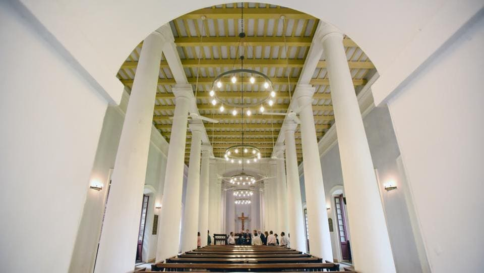 St. Olav's Church has a portico of twin columns and the royal monogram of Christian VII, who was the King of Denmark when the church was consecrated. It is flat roofed and reflects the designs of contemporary churches in British India.  (Burhaan Kinu / HT Photo)