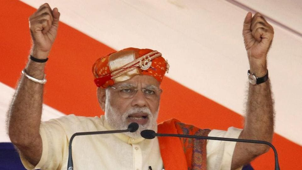 Prime Minister Narendra Modi addresses a rally for election in Lunawada town of Panchmahal district of Gujarat on Saturday.