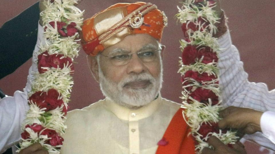 Prime Minister Narendra Modi being garlanded at an election campaign rally in Lunawada town of Panchmahal district in Gujarat on Saturday.