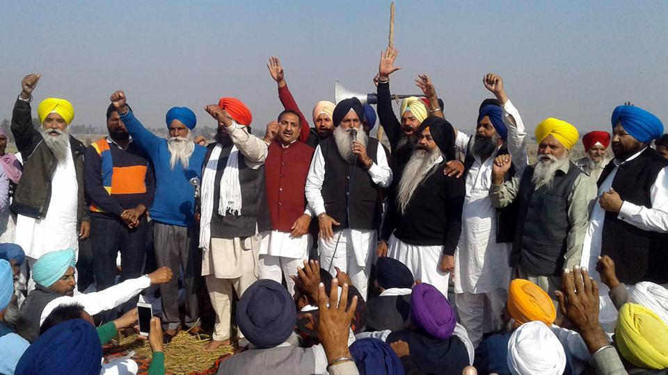 Former SAD MLA from Khemkaran constituency Virsa Singh Valtoha (centre) addressing party workers during a blockade at Kot Budha bridge, which connects Patti and Ferozepur, at Patti on Friday.