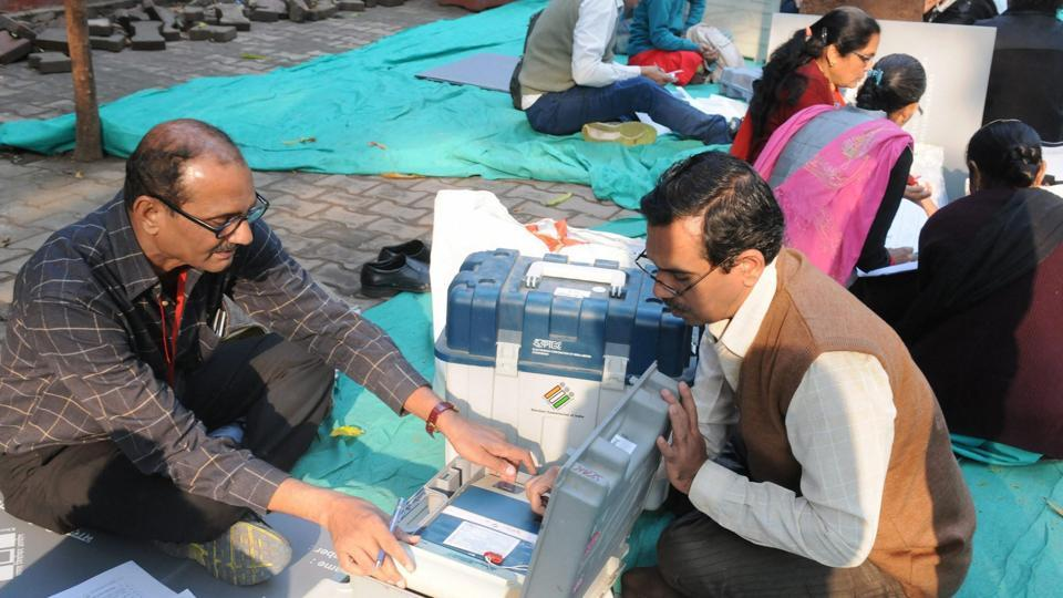 Polling officials check the EVMs in Surat on the eve of the first phase of the Gujarat assembly election.