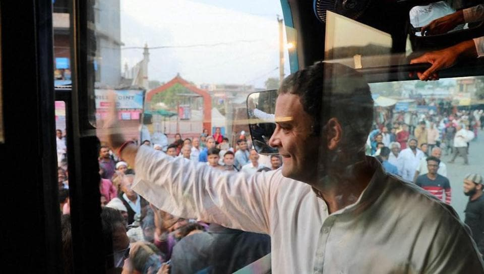 Congress vice-president Rahul Gandhi waves to his supporters at Kheda district in Gujarat on Friday during election campaign.