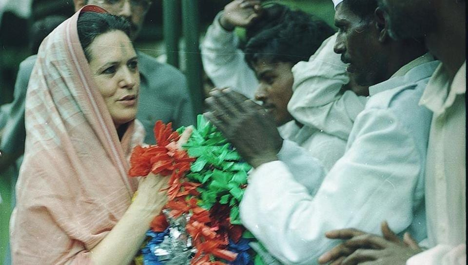Sonia Gandhi is greeted by her supporters on May 17, 1999. On the day, after members of the Congress Working Committee led by Sharad Pawar questioned her foreign origin and posed her as  a liability, Sonia Gandhi resigned as the party president.  She later rejoined office on May 24, 1999. (Pradeep Singh / HT ARCHIVE)