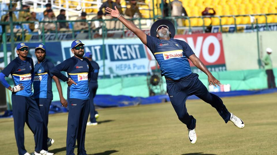 Sri Lankan captain Thisara Perera jumps for a catch during their practice session ahead of the first ODI against India at the HPCA Stadium in Dharamshala on Saturday.