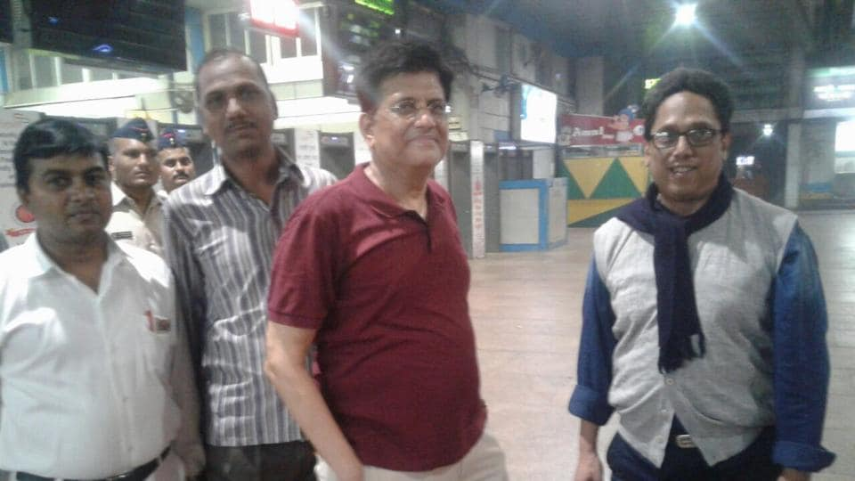 Union minister Piyush Goyal (in red) with activist Sameer Zaveri (right) at Churchgate station on Friday night.