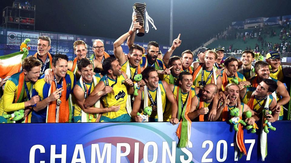 Australian hockey team players celebrate with the winners' trophy after beating Argentina in the gold-medal match of the FIH Men's Hockey World League Final 2017 at Kalinga Stadium in Bhubaneswar on Sunday.