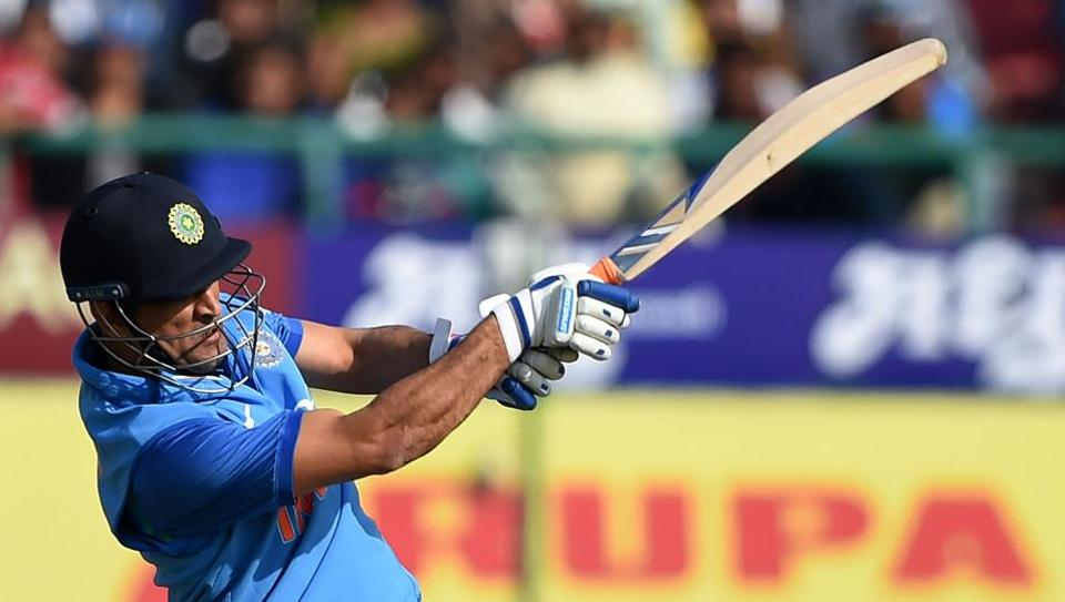 Indian cricketer Mahendra Singh Dhoni plays a shot during the first One day international (ODI) match between India and Sri Lanka at the Himachal Pradesh Cricket Association stadium in Dharamshala on December 10, 2017. Dhoni top-scored for India with 65.